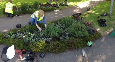 Volunteers working on the flowerbeds at Oakham Library